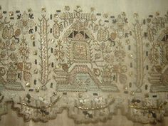 Silk & metal ('silver') thread embroidered linen 'yağlık' (large handkerchief, usually worn in the waist belt).  Late-Ottoman era, early 19th century.  This is 'two-sided embroidery' (front and rear are identical).   Techniques: 'pesend' (double running stitch) an 'tel kırma' (small geometrical motives obtained by sticking narrow metallic strips through the fabric and folding them).