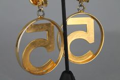 Vintage Chanel no.5 earrings, gold hoops featuring iconic number 5 in center, clip on back AVAILABLE NOW  email: cat@catapolinar.com