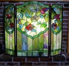 Magnificent Seaside Stained Glass...I'd love this with candles lit in the fireplace. Wouldn't use it with a log fire though!