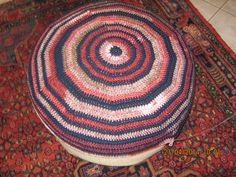Pouffe cover made with cheap Kismet yarns so I dare put my feet on it!