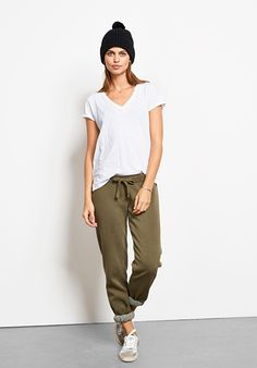 "These comfortable joggers are so versatile and easy to wear; works as well with a tee and trainers as they do rolled up with heels. Washed for a soft worn look. • A straight-leg fit with a low rise, these joggers are designed to be worn low slung. Relaxed fit that is true to size. • Ribbed cuffs. • Drawstring and elasticated waist. • Soft, medium weight fabric. • Inside leg 78.5cm (all sizes) • Model is 5'10"" and wears size S."