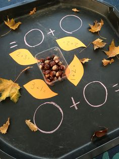 Autumn maths station - addition using conkers.