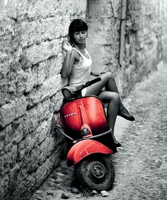 Even a beat up scoot looks better with an attractive girl on it.