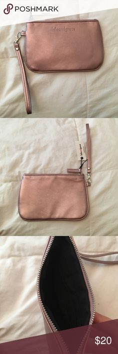 LOLA & GRACE Pink Shiny Wristlet New with tags! Great wristlet. 3 card slots inside! Lola&Grace Bags Clutches & Wristlets