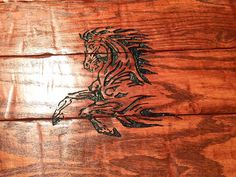 Up close picture of the rustic engraved horse center on a reclaimed oak coffee table made by Country Cowgirl's Creations. Solid oak Coffee table on sale Check us out on Facebook!