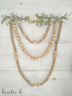 Using wooden beads a string and little more, make this beautiful boho nordic wooden bead wall hanging in no time!