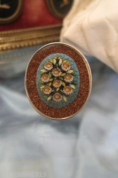 Oval Micro Mosaic Brooch with White Flowers Set in Silver 19th Century