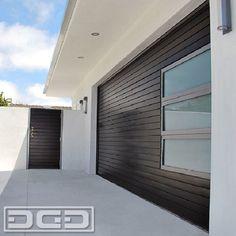 Mid Century Modern Garage Doors & Gates by Dynamic Garage Door. Horizontal slat design with windows. Get a consultation at: 855-343-3667 by DynamicGarageDoors