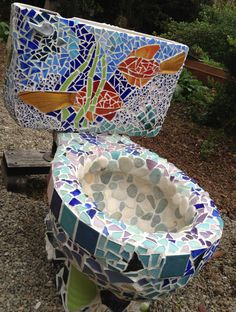 Fun project!  Using ceramic, glass, & various small objects to mosaic an old toilet destined to grace the garden as a fountain, hopefully.