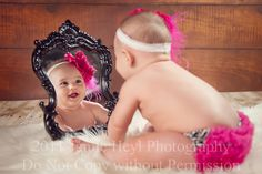 baby in mirror.. So cute doing this one day when it's baby time