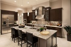 Mirabella - A kitchen that would make you love to cook! A Monogram gas range!! #Devonwood #SWFL #CatFoster