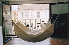 Charlotte wants a hammock in her bedroom (instead of a bed). Here's one idea.