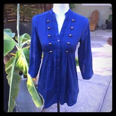 Button up military tunic shirt Navy blue button up military tunic shirt from Nordstrom Rack. Has small white stain like on sleeve area as shown on last photo. Golden brass color button details on shirt has some scuffs. Tops Tunics