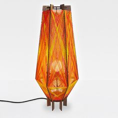 Andromeda Aero floor lamp in the Sunset color way. Sculptural mid-century modern inspired lighting