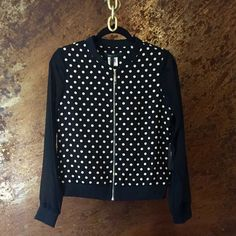 Bomber Jacket HOST PICK! Polka Dot Bomber Jacket. Front Zip Closure. Sheer Sleeves. Go casual with a white tee and statement necklace, or wear over a dress for a night out BCBGMaxAzria Jackets & Coats
