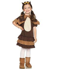 a little girl wearing an owl costume