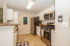 Our upgraded kitchens feature granite countertops and stainless steel appliances. #Amenities #ArriveFortLee #IHaveArrived #FortLeeApartments Stainless Steel Appliances, Home Appliances, Fort Lee, Apartment Communities, Stacked Washer Dryer, Luxury Apartments, Granite Countertops, Kitchen Cabinets, Kitchens