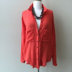 "TODAY ONLY FREE PEOPLE TOP Generous size Medium to be worn loose. Orange with bronze button front, two front pockets, tulip back. Soft, double weave cotton. Point collar.  Chest pockets Long sleeves with button tabs for rolled styling Vented sides with button closures. 52"" chest surround. Adjustable arms length up to 20"". 28"" front length. No trades. Free People Tops Button Down Shirts"