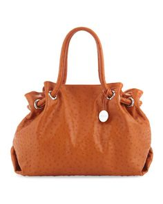 I picked up this furla bag in a shiny red patent leather at a local resale shop - gorgeous!