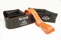 se trata del modelo de Cinturón Ruso o Tirante Musculador TMR Home Edition 1 en color negro y naranja