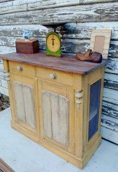 Annie Sloan Chalk Paint -- Arles and Old Ochre. Stained top with white wax rubbed into the cracks.