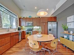 Silestone counters, hardwood floors and stainless steel appliances 5908 Lux St, Austin, TX 78721