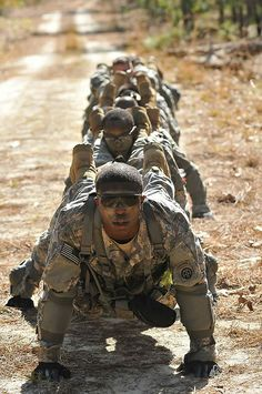 Paratroopers from the 1st Squadron, 73rd Cavalry Regiment, 2nd Brigade Combat Team, 82nd Airborne Division, perform a team pushup in unison during the modified physical training test event of the battalion's Spur Ride qualification course on Fort Bragg, N.C., #USArmy
