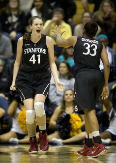 Stanford's Bonnie Samuelson (41) and Amber Orrange celebrate Samuelson's made basket -- with a foul -- against California