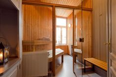sauna, basement, nice to have glass doors instead of wood.