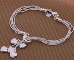 Make a heartfelt statement in style with this beautiful 5 hearts silver-plated bracelet.  A look everyone will love, this sweet femininity has 5 hearts dangling from a beautiful silver chain.      	Comes in a lovely velvet pouch.   | Shop this product here: http://spreesy.com/BraveStarGifts/36 | Shop all of our products at http://spreesy.com/BraveStarGifts    | Pinterest selling powered by Spreesy.com