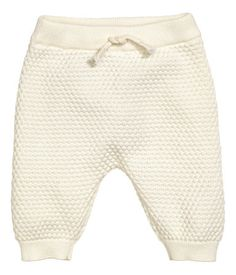 BABY EXCLUSIVE/CONSCIOUS. Soft organic cotton trousers in a textured knit with an elasticated waist with a decorative drawstring, and ribbed hems.