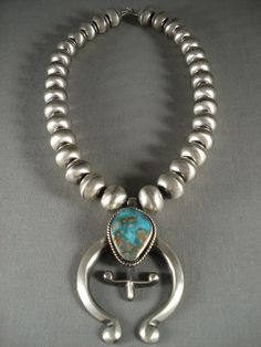 "Because of the chunky style silver bead necklace, it will fit more like a choker style with pendant. Sterling silver, marked. Signed by Navajo artist, Eugene Hale. The length of the necklace measures around 22"". 