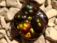 Fire Agate Cabochon #Arizona #Gemstone  This small Arizona Fire Agate cabochon measures 8 mm x 7 mm x 2 to 3 mm in thickness and weighs 2.2 carats. This gemstone was cut by Thomas Cameron of Maricopa Mining.