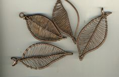 additions to my EarthenWear collection - large leaf pendants with hammered frames  each utilizing  a different weave technique.