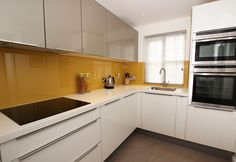 white, greige, ocre kitchen. maybe a more interesting floor...texture? pattern? veined material?
