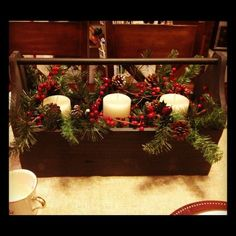 love the Christmas greens with candles