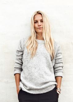 Danish Caroline Flemming wearing a cozy grey knit. Perfect for autumn.