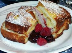 Monte Cristo Sandwich from Food.com: A great brunch item! Baked, french toast style, sandwiches filled with cheese, ham, turkey & mustard. Raspberry preserves is a must. Could be eaten for breakfast, lunch or dinner. This is a LESSER FAT Monte Cristo recipe being baked and not fried, full of flavor!