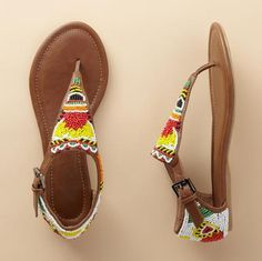 Recalling beaded trading post belts, this vibrant sandal perks up shorts, jeans and sundresses all season long. Enclosed heel, flat manmade sole. Imported. Whole sizes 6 to 11.
