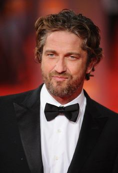 Gerard Butler, This man is like a human chameleon, hence his versatility. He can be any kind of man that he wants to be. When he portrays sadness or regret, he can break your heart but one of his lovely smiles,or when he laughs, or pulls a goofy face, he makes you feel so happy.