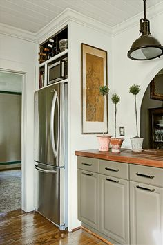 Fridge built in cabinet and countertops. An oldie but goodie from Cottage Living. How do you use the high up microwave though? Kitchen Corner, Kitchen Redo, New Kitchen, Kitchen Remodel, Kitchen Cabinets, Kitchen Ideas, Kitchen Inspiration, Gray Cabinets, Cupboards