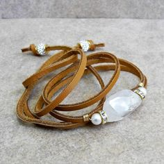 Leather Cord Bracelet with Faceted Moonstone, Pearls and Rhinestones - Gold and Moonstone Bracelet - Leather Wrap - Roca Jewelry Designs by RocaJewelryDesigns on Etsy https://www.etsy.com/listing/279111952/leather-cord-bracelet-with-faceted