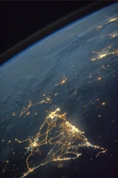 From the orbital perspective of NASA astronaut Karen Nyberg, Oman and the United Arab Emirates in Earth's seas, infinity beyond the horizon 19 July 2013.
