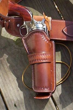 Cowboy Fast Draw legal holster with Steel insert leather covered bullet deflector. order with plain bordered or fully tooled. - See this image on Photobucket.