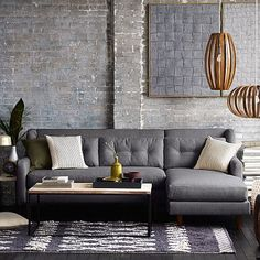Love the coffee table nestled into the sectional {West Elm, Crosby 2-Piece Chaise Sectional}