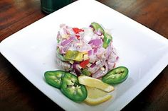"""The Filipino version of ceviche.  To cook in """"kinilaw"""" means to make the meat edible by soaking it in vinegar and adding salt and other spices when the meat becomes opaque in color. The vinegar acts as a cooking agent in this process."""