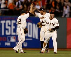 San Francisco Giants' Juan Perez (2), San Francisco Giants' Hunter Pence (8) and San Francisco Giants' Gregor Blanco (7) celebrate their 6-4 win against the St. Louis Cardinals of Game 4 of the National League baseball championship series in San Francisco, Calif., on Wednesday, Oct. 15, 2014.  (Nhat V. Meyer/Bay Area News Group)