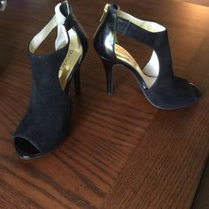 MICHAEL Michael Kors Stilletos HP Black suede and patent leather peep toes with back gold zipper detail. These shoes have never been worn outside the house. Price is firm. MICHAEL Michael Kors Shoes Heels