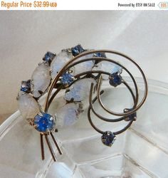 This  #vintage molded glass brooch is just lovely!  It features a silver tone pin with round blue prong set rhinestones and molded glass pale blue marquise shaped rhinestone... #ecochic #etsy #jewelry #jewellery #holiday2014etfs
