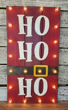 20 Fun Christmas Decorations Ho Ho Ho Wood Plank sign – simple, fun, and creative – love the lights too! You've finished your Christmas crafts and cookies and now it's time to put up your Christmas decorations. You're going to love these Christmas ideas! Pallet Christmas, Noel Christmas, Simple Christmas, Christmas Ornaments, Diy Outdoor Christmas Decorations, Rustic Christmas, Wooden Christmas Crafts, Christmas Movies, Diy Christmas Projects